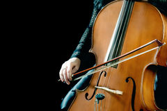 Musical instruments cello. Playing cellist closeup Royalty Free Stock Images