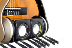 Musical instruments created with concept photo with guitar, melodica, small speakers and headphones royalty free stock photos
