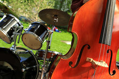 Musical instruments. Double bass in the background of the drum Royalty Free Stock Images