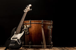 Musical instruments, drum bass Bochka bass guitar on a black background. The music concept stock photography