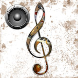 Musical instruments in the hole treble clef Stock Images