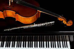 Musical instruments lying on the piano Stock Photography