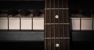 Musical instruments piano keys and acoustic guitar Royalty Free Stock Image