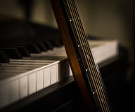 Musical instruments piano keys and acoustic guitar Stock Photos