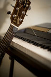 Musical instruments piano keys and acoustic guitar Royalty Free Stock Photos