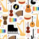 Musical instruments seamless pattern. Musical instruments seamless background pattern with colored vector icons depicting drums  mandolin  guitar  keyboard  harp Stock Photo
