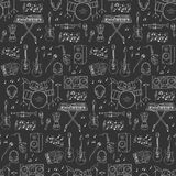 Musical instruments and symbols  seamless background. Music icons vector illustrations hand drawn doodle seamless background.  Musical instruments and symbols Stock Image
