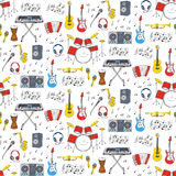 Musical instruments and symbols  seamless background. Music icons vector illustrations hand drawn doodle seamless background.  Musical instruments and symbols Stock Photography