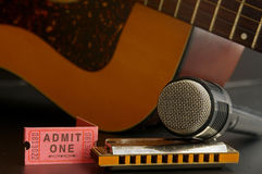 Musical instruments and ticket. Guitar and harmonica stock photo