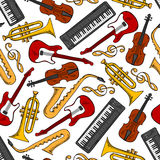 Musical instruments, treble clefs seamless pattern Royalty Free Stock Image