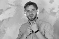 Musical lifestyle. American handsome bearded guy with headphones. stock photography