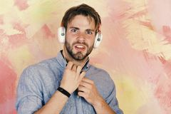 Musical lifestyle. American handsome bearded guy with headphones. stock image