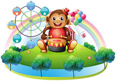 A musical monkey near the ferris wheel Royalty Free Stock Photos