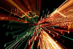 Musical Nightmare. Time exposure photo of Christmas lights with camera movement, 3-D effect, - painting with light - original art Stock Images
