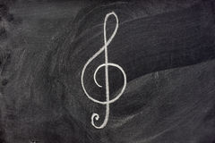 Musical notation sign on blackboard Stock Photo