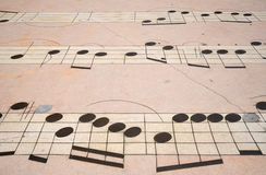 Musical Note abstract background. A  musical scale on the ground within the city of Qingdao China to create an abstract background Royalty Free Stock Photography