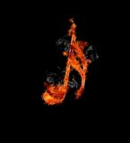 Musical note on fire. Stock Photos