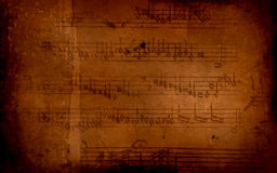 Musical note. On grunge old paper Stock Photography