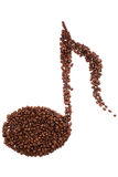 Musical note shape made of coffee beans over white background.  Stock Photo