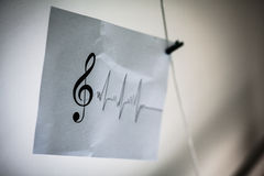 Musical note and simple diagram. On sheet paper Royalty Free Stock Image