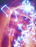 Musical notes. With sparkles on a colourful background Royalty Free Stock Images