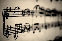 Musical notes. Vintage picture with musical notes in a grand staff Royalty Free Stock Images