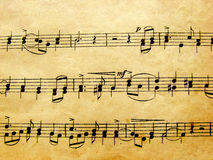 Musical notes. A detail of vintage musical notes Stock Images