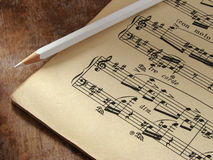 Musical notes. Sheet of musical symbols with pencil Royalty Free Stock Photography
