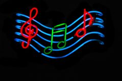 Musical Notes. Neon sign with musical notes stock photo