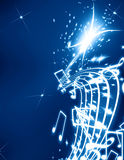 Musical notes. On a glittering dark blue background Stock Image