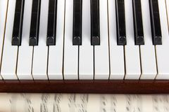Musical notes on the background of a piano. Background. Musical notes on the background of a piano Royalty Free Stock Photos