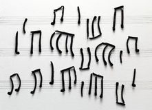 Musical notes burned matches Stock Images