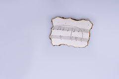 Musical notes on a burnt paper on white background Stock Image