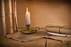 Musical notes and candle Royalty Free Stock Images