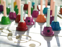 Musical Notes and the Colorful Bell Royalty Free Stock Photos