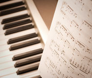 Musical notes on composer or piano. Studio shot royalty free stock images