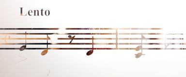 Musical notes on frosted glass, art background Royalty Free Stock Image
