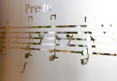 Musical notes on frosted glass, art background Stock Image