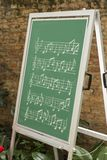 Musical notes on green. Chalkboard stock photo