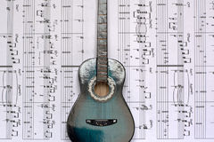 Musical notes and guitars Royalty Free Stock Photo