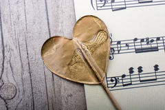 Musical notes and heart shaped icon Stock Photos