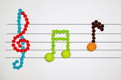 Musical notes with macarons Stock Photography