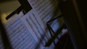 Musical notes on the music stand. Close-up stock footage