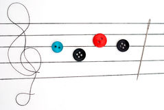 Musical notes on needlework Royalty Free Stock Photography