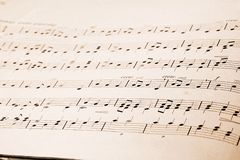 Musical notes in old music book. Musical notes in old grungy music book stock image