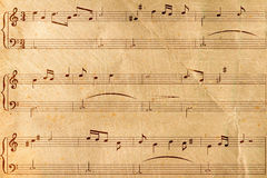 Musical notes on old paper. The Musical notes on old paper sheet Royalty Free Stock Photos