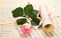 Musical notes and pink rose Stock Images