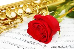 Musical notes and saxophone Royalty Free Stock Photos