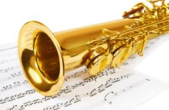 Musical notes and saxophone. Isolated on white Stock Images