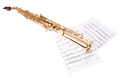 Musical notes and saxophone. Isolated on white royalty free stock photo